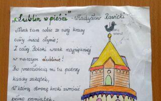 Karka papieru z tekstem i rysunkiem
